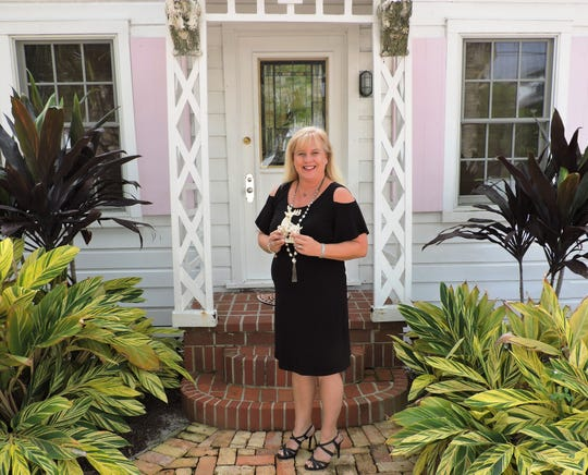Sharon Gorie of Dramatic Décor outside The Ernest Lyons House