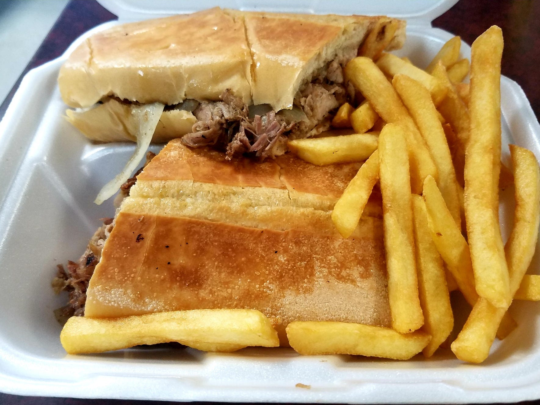 Quetzel's Bread with Pork was pressed Cuban bread loaded with close to a pound of shredded pork. It was served with fries.