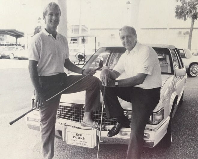 "Russell G. ""Ace"" Cappelen, right, and his son, Rusty, pose at the Ken Puttick Buick & Cadillac dealership in Vero Beach in this undated picture from the mid-1980s. The dealership was a sponsor in the annual tournament to benefit the Indian River County Volunteer Ambulance Squad. The tournament, which Ace Cappelen ran for more than 20 years, raised hundreds of thousands of dollars to buy ambulances for local volunteer ambulance squads."