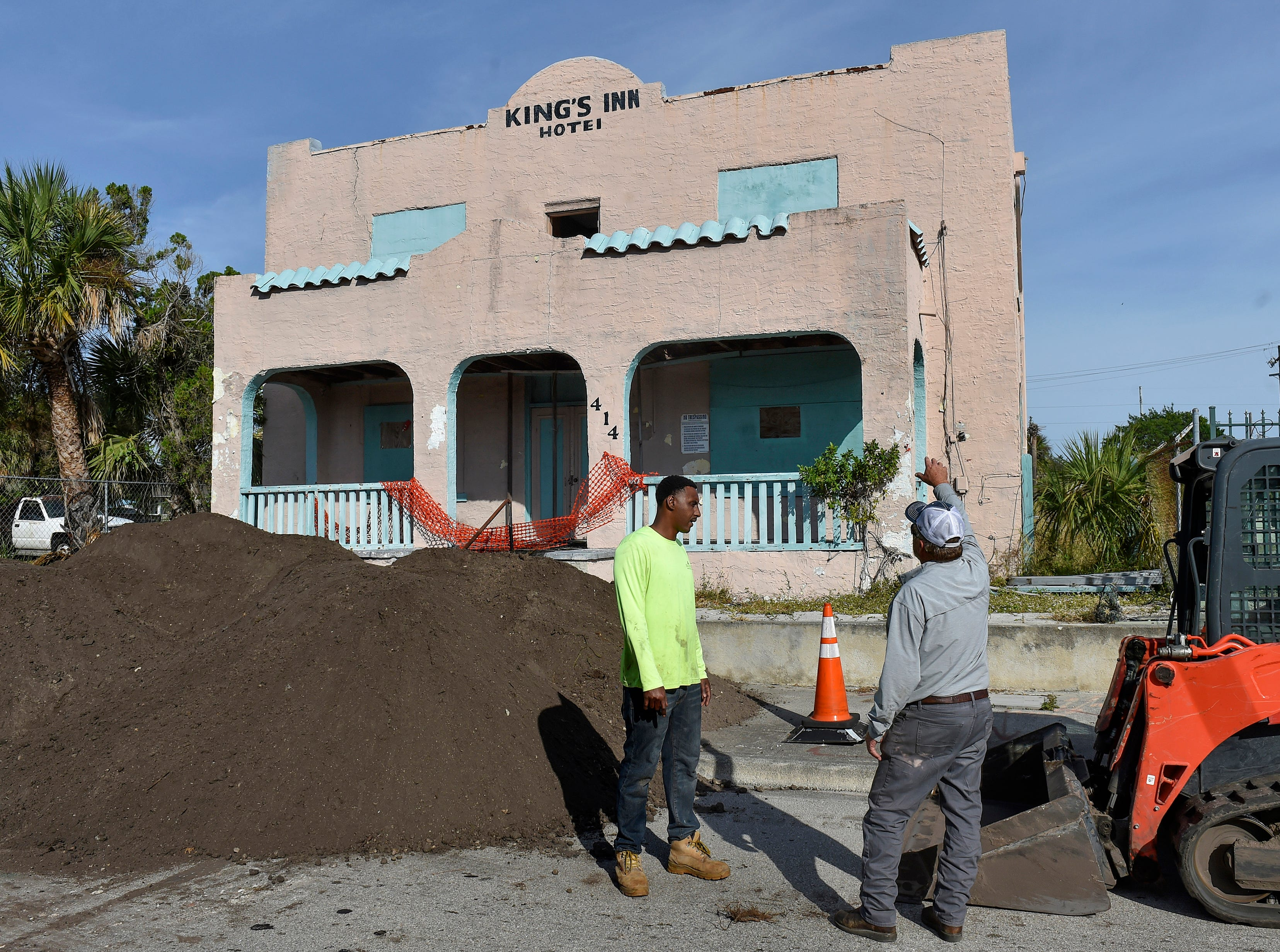 Jerome Mims (left), of A & L Remediation Services, and Mike Fidler, of Samsula Demolition, both of New Smyrna Beach, prepare for the demolition of the old King's Inn building at 414 Avenue D on Monday, Nov. 26, 2018, in Fort Pierce. The King's Inn, a 5,624 square foot hotel constructed in 1926, has been vacant for more than a decade, and is under deconstruction through Monday, Dec. 3, closing Avenue D from U.S. 1 to North 7th Street.