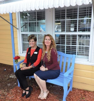 Florence Oreiro, Mary's Shelter Board member and Madeleine Greenwood,Outreach & Development Coordinator of Mary's Shelter outside The Cottage