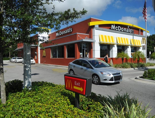 Drive-through traffic only is permitted at a McDonald's restaurant in the 1900 block of U.S. 1 in Vero Beach Sept. 2, 2014 as the Vero Beach Police Department investigates a Sept. 1 fatal stabbing that occurred in the restaurant's parking lot.
