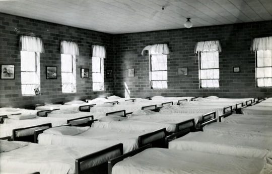 Inside the residence for the boys – their beds.