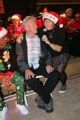 "Fort Pierce Jazz and Blues Society member Wendy Dwyer sings the holiday classic ""Santa Baby"" to Steven Knapp at last year's Ring-a-Ding-Ding Holiday Fling"