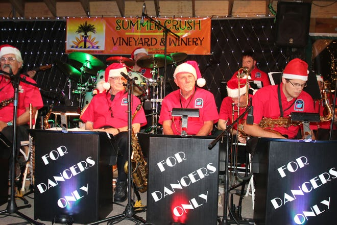 Members of Fort Pierce Jazz and Blues Society's 17-piece big-band, FDO (For Dancers Only) get the crowd into the holiday spirit at last year's Ring-a-Ding-Ding Holiday Fling