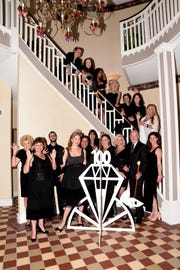 """Main Street Vero Beach staff, board members, volunteers and sponsors gather for a photograph as they prepare for the New Year's Eve """"Party of the Century: Diamonds are Forever"""" event in downtown Vero Beach."""