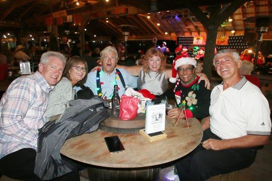 Steve and April Knapp, Dan Hafner, Kim Laffont, Dr. Shamsher Singh, and Julian Laffont enjoy music and camaraderie courtesy of Fort Pierce Jazz and Blues Society at last year's Ring-a-Ding-Ding Holiday Fling at Summer Crush Winery & Vineyard.