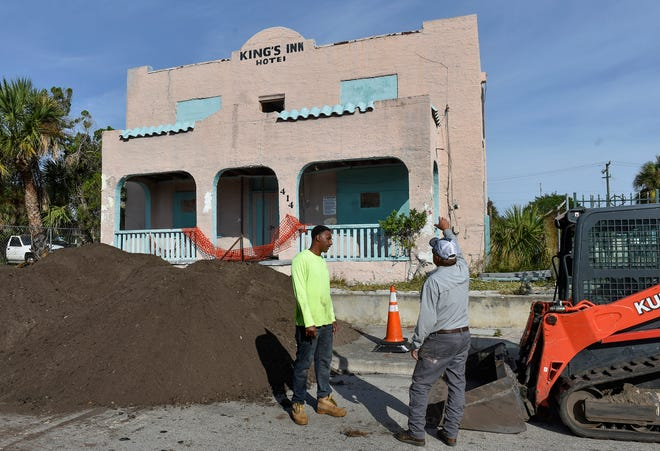 Jerome Mims (left), of A & L Remediation Services, and Mike Fidler, of Samsula Demolition, both of New Smyrna Beach, prepare for the demolition of the old King's Inn building at 414 Avenue D on Monday, Nov. 26, 2018, in Fort Pierce. King's Inn, a 5,624 square foot hotel constructed in 1926, has been vacant for more than a decade, and is being demolished through Monday, Dec. 3, closing Avenue D from U.S. 1 to North 7th Street.