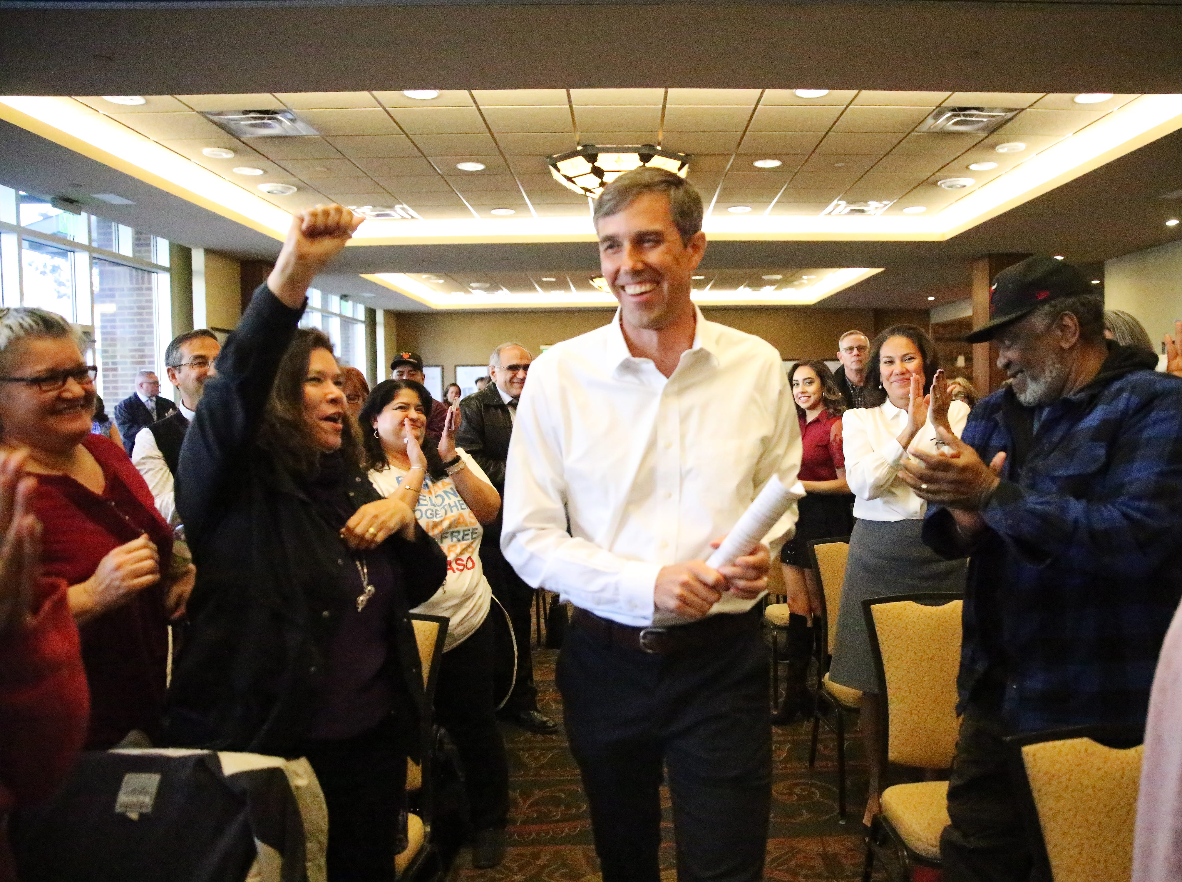 U.S. Rep. Beto O'Rourke walks into his first town hall since the midterm elections to applause from the capacity crowd Monday at the El Paso Community Foundation room in downtown El Paso. O'Rourke introduced his successor, U.S. Rep. elect Veronica Escobar and touched upon a variety of issues and answered a variety of questions, from migrants at the border to gun control legislation to his future plans.