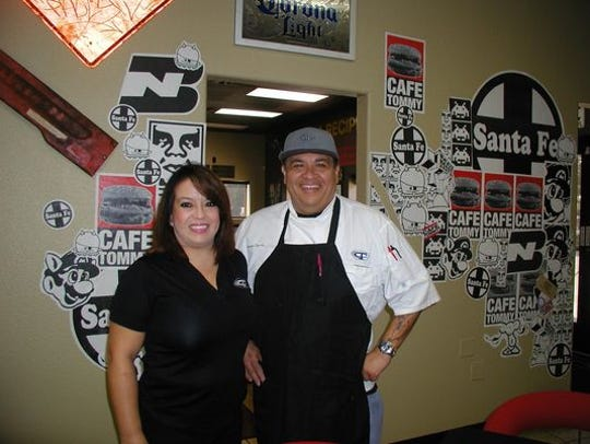 The Cafe owners Tommy and Vanessa Chavez pose inside their restaurant in this Nov. 2015 file photo.