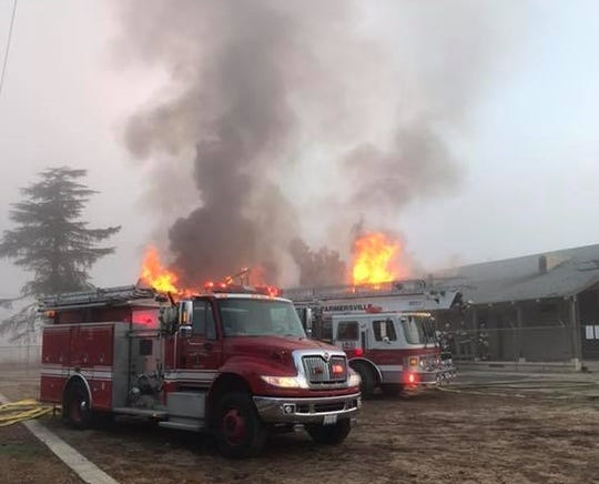 Tulare County firefighters are working to contain a fire burning near Farmersville.