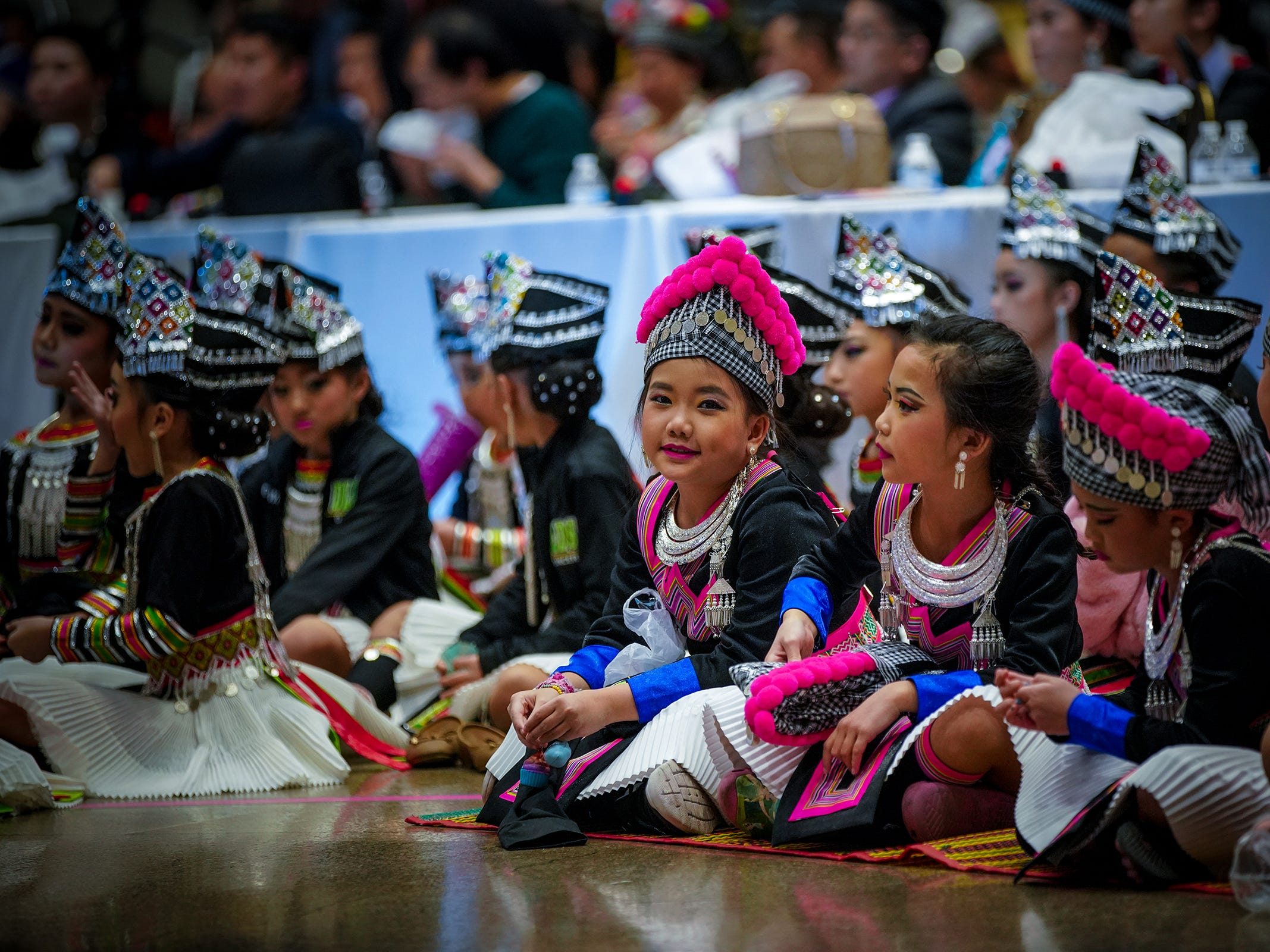Thousands of Hmong across Wisconsin traveled over the weekend to celebrate one of the largest Hmong festivals in the country, the 40th Annual Minnesota Hmong New Year event, held at the RiverCentre in St. Paul, MN. The three-day celebration ran Friday through Sunday, Nov. 23rd to 25th, with activities that included, among other things, traditional ball tossing, folk songs, cultural dances and a pageant competition. Many Hmong dressed in colorful attire and showcased hand-made jewelries to celebrate achievements from throughout the year. T'xer Zhon Kha/USA TODAY NETWORK-Wisconsin