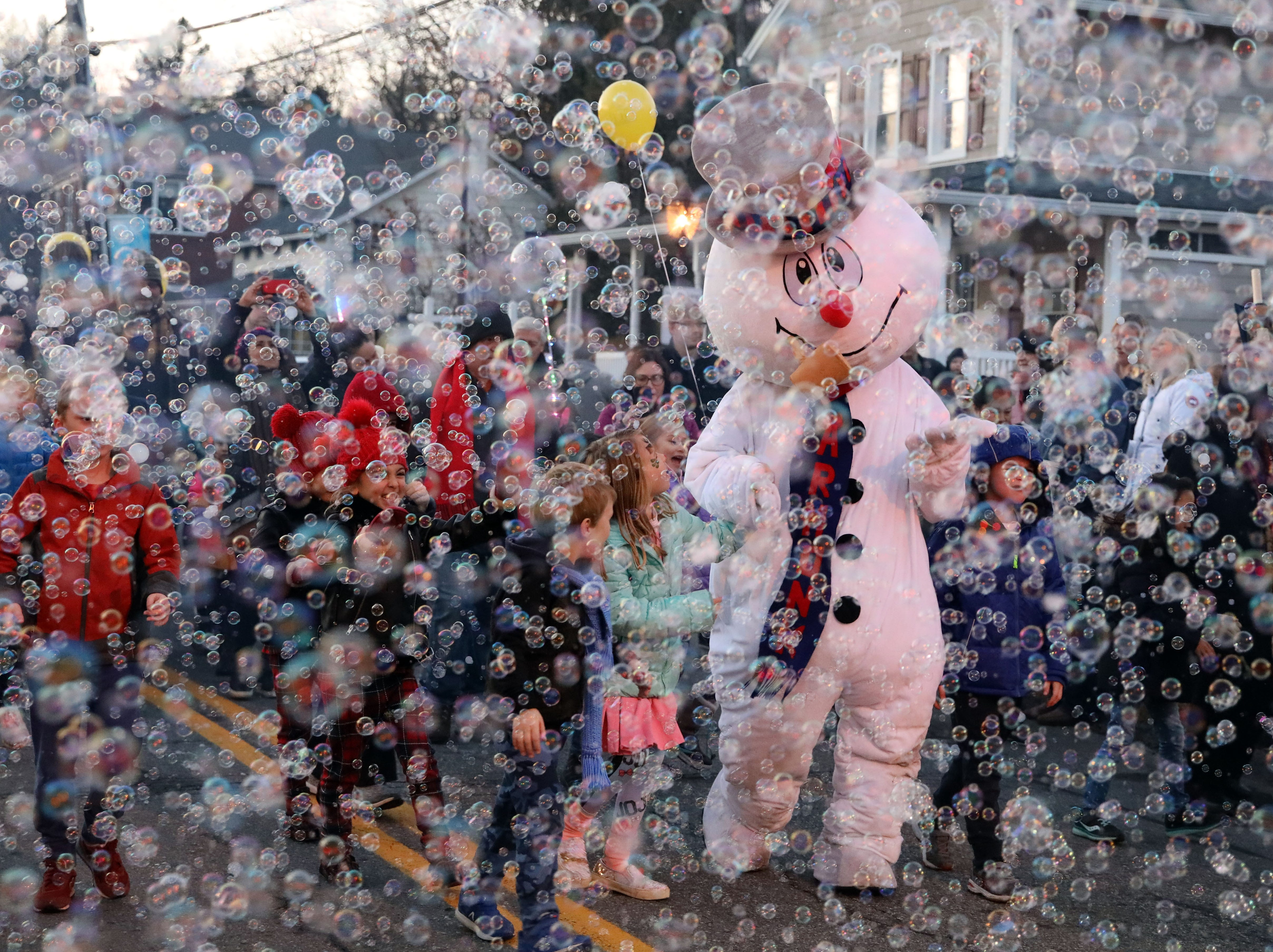 """Frosty the Snowman marches in the 9th annual Frosty Day parade in Armonk Nov. 25, 2018. Steve Nelson wrote the song """"Frosty the Snowman"""" in 1953 when he lived in Armonk."""