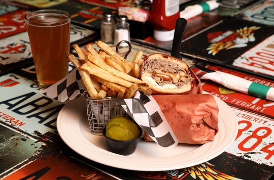The Knuckle sandwich (thinly sliced roast beef, mozzarella sticks, chicken fingers, fries, sauteed onions and brown gravy on garlic ciabatta bread) at Knuckles Incorporated restaurant in Stony Point Nov. 26, 2018.