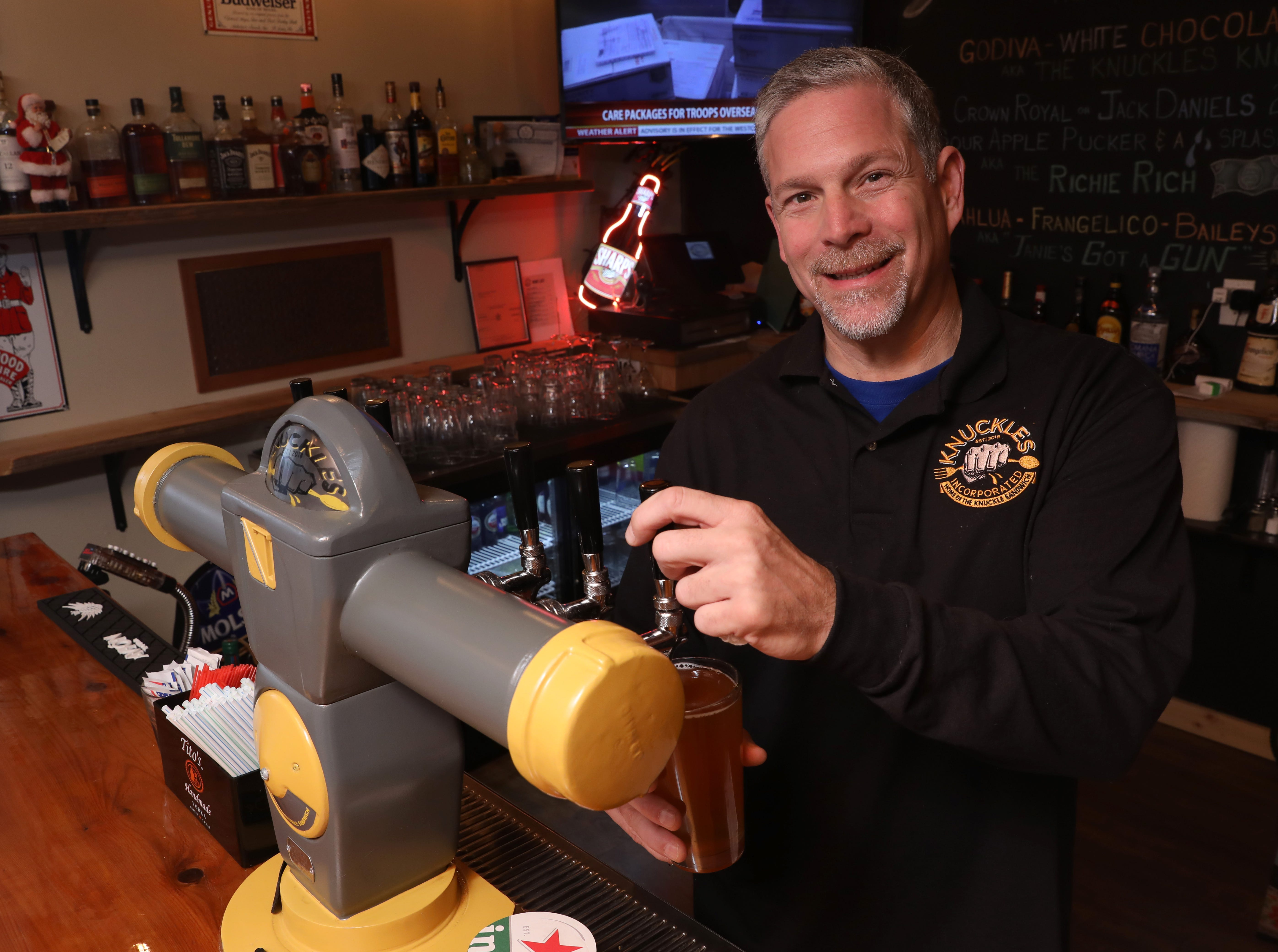 Owner Ken Stadt pours a Defiant Brewing Co. beer from the tap, which is a 1970s New York CityÊparking meter, at Knuckles Incorporated restaurant in Stony Point Nov. 26, 2018.
