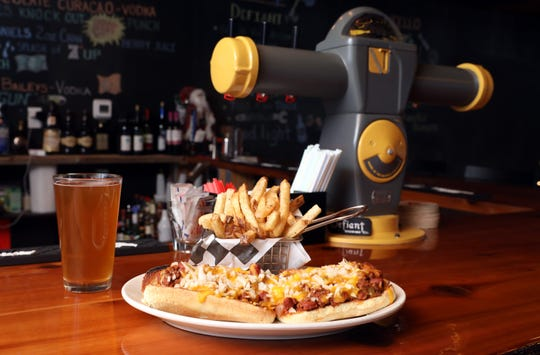 The Chilli Carne Dog at the bar, where the tap is a made from a 1970s New York City parking meter at Knuckles Incorporated, a new restaurant in Stony Point Nov. 26, 2018.