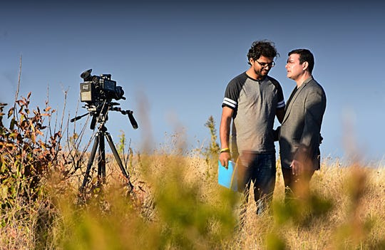 """Actor Ed Aristone, who plays Frederick in the movie """"Delaware Shore,"""" talks with filmmaker/director Raghav Peri during shooting at Slaughter Beach."""