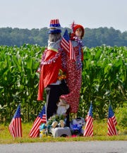 "In this photo posted July 3 on his Facebook page, Cape Gazette reporter Ron MacArthur wrote, ""Pole Man and his family on Route 9 near Lewes are decked out for July 4th."""