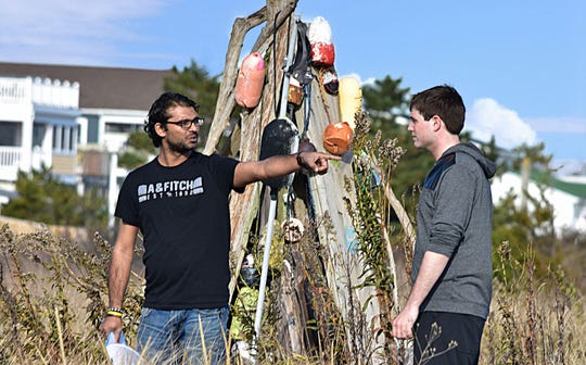 """James Robinson Jr., who plays Gallagher in the movie """"Delaware Shore,"""" takes direction from filmmaker/director Raghav Peri during shooting this summer at Slaughter Beach."""