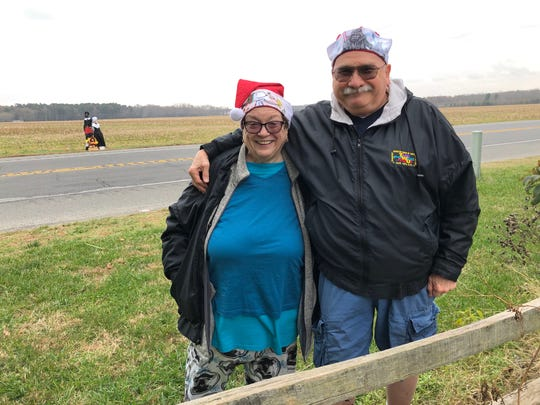 "Angela and Ralph Nerbel often drive on Del. Route 9 near Lewes and see ""The Pole Family."" Last week, they donned Santa Claus hats and decided to take photos of the pole, which were dressed like Pilgrims."