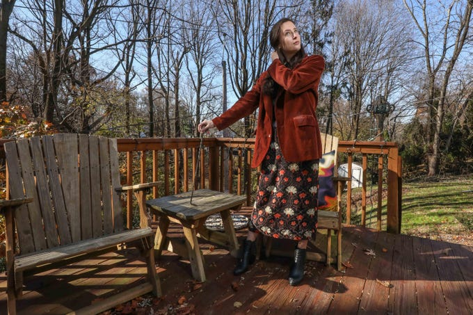Holt Querey wears a vintage corduroy blazer; vintage maxi dress; Alexander Wang signature booties and rings from Gucci and her grandmother and mother.