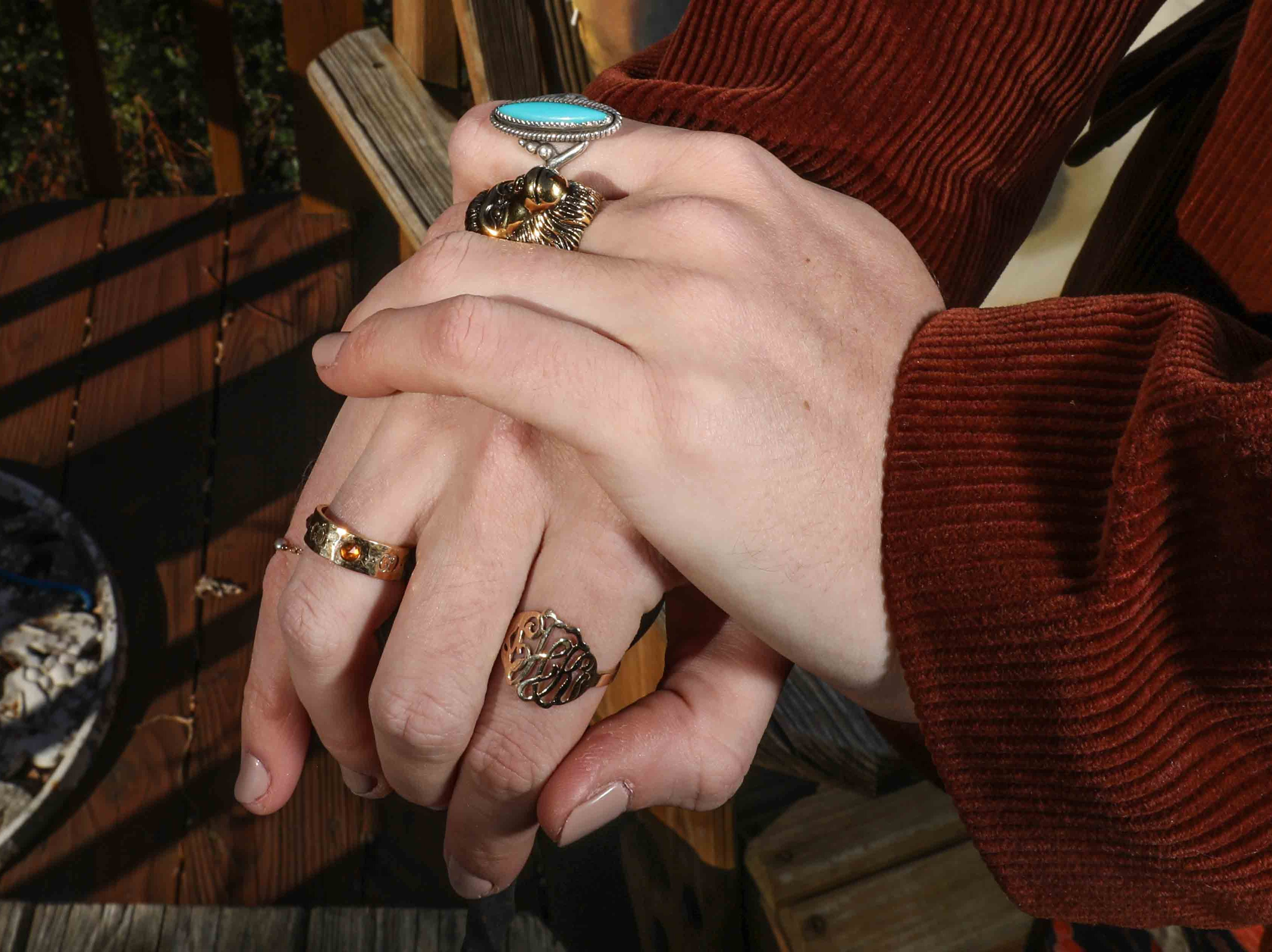Holt Querey wears a Gucci ring with her grandmother's and mother's rings.