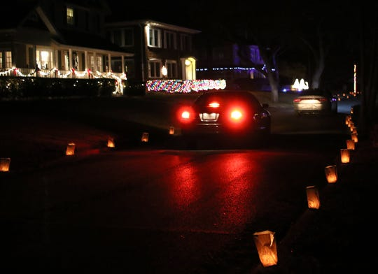 Morningside Luminaries on display for Christmas. Cars drive through Morningside Addition to see more than 1,500 candles inside paper bags and homes decorated with Christmas lights.