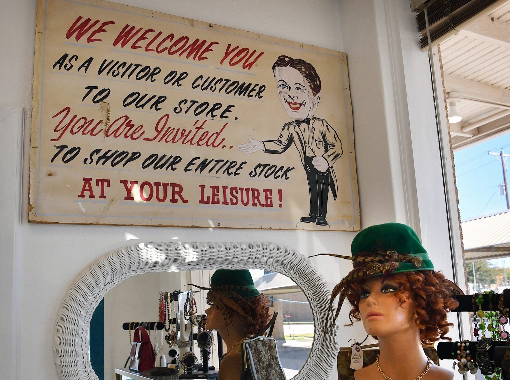 A sign original to the former Gragg Motor Company now welcomes customers into the new Fashion Garage, a vintage clothing boutique.