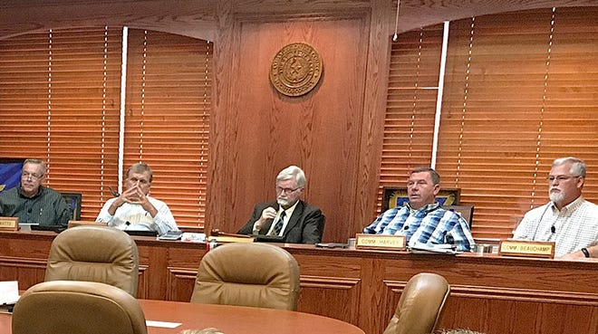 Wichita County Commissioners Court signed a resolution Monday opposing unfunded state mandates and requesting an amendment to the state constitution.