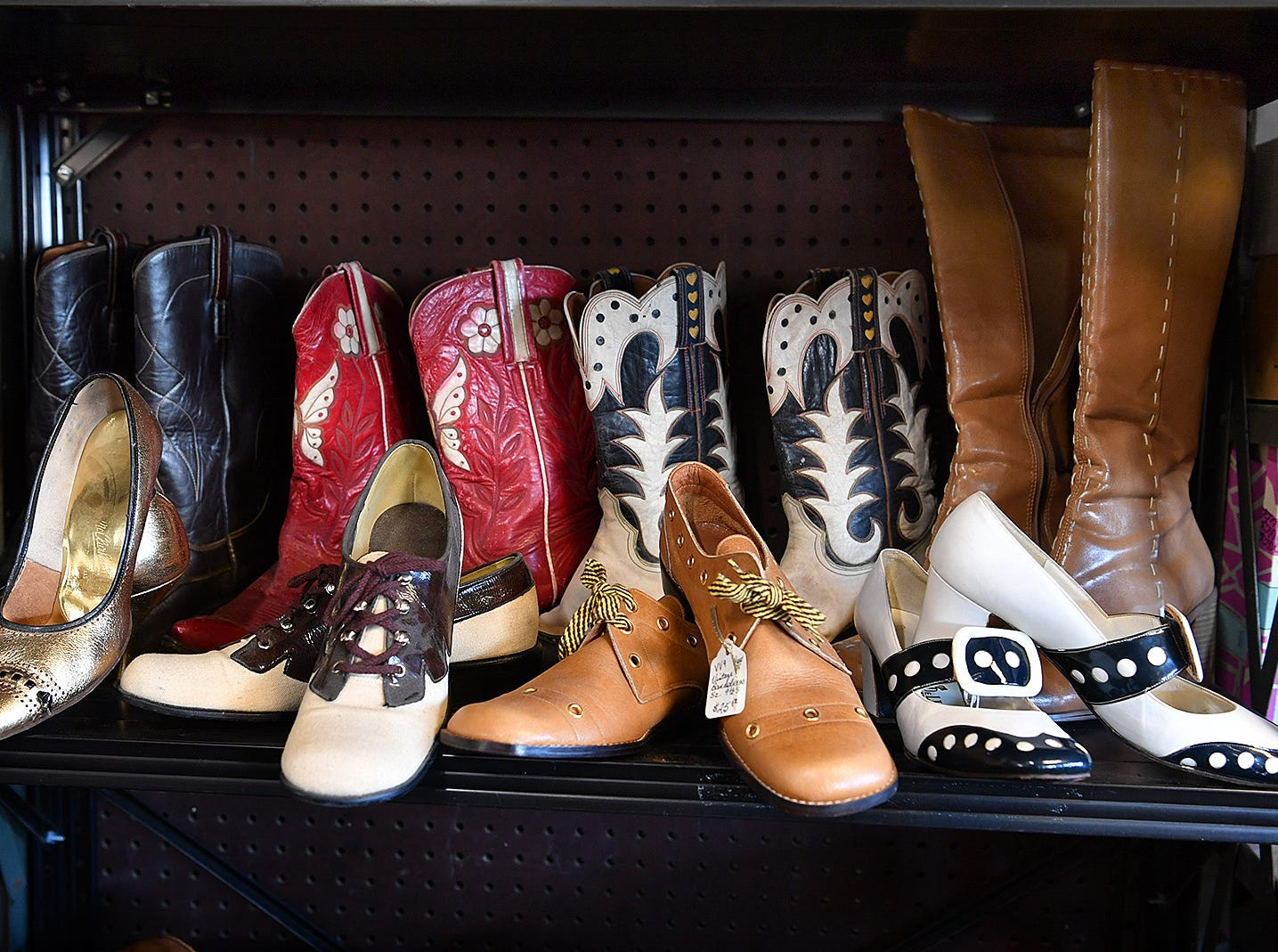 A display of shoes and boots at Fashion Garage, a retro and vintage fashions boutique in the building of the former Gragg Motor Company car lot.