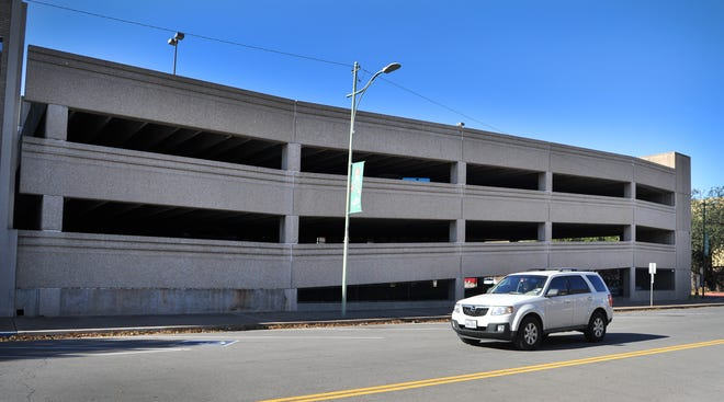 The Lindemann Parking Garage downtown attracts vandalism as city mulls what to do with it.