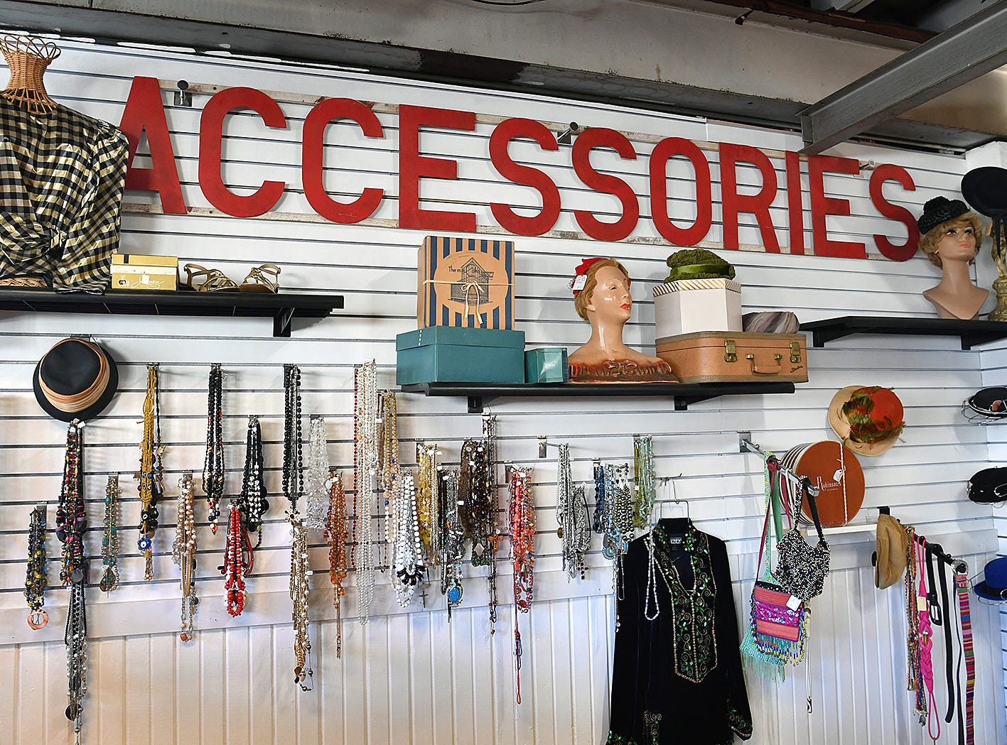 The Fashion Garage offers vintage, retro and contemporary clothing, shoes, jewelry and accessories and recently opened in the former Gragg Motor Company at 12th Street and Lamar.