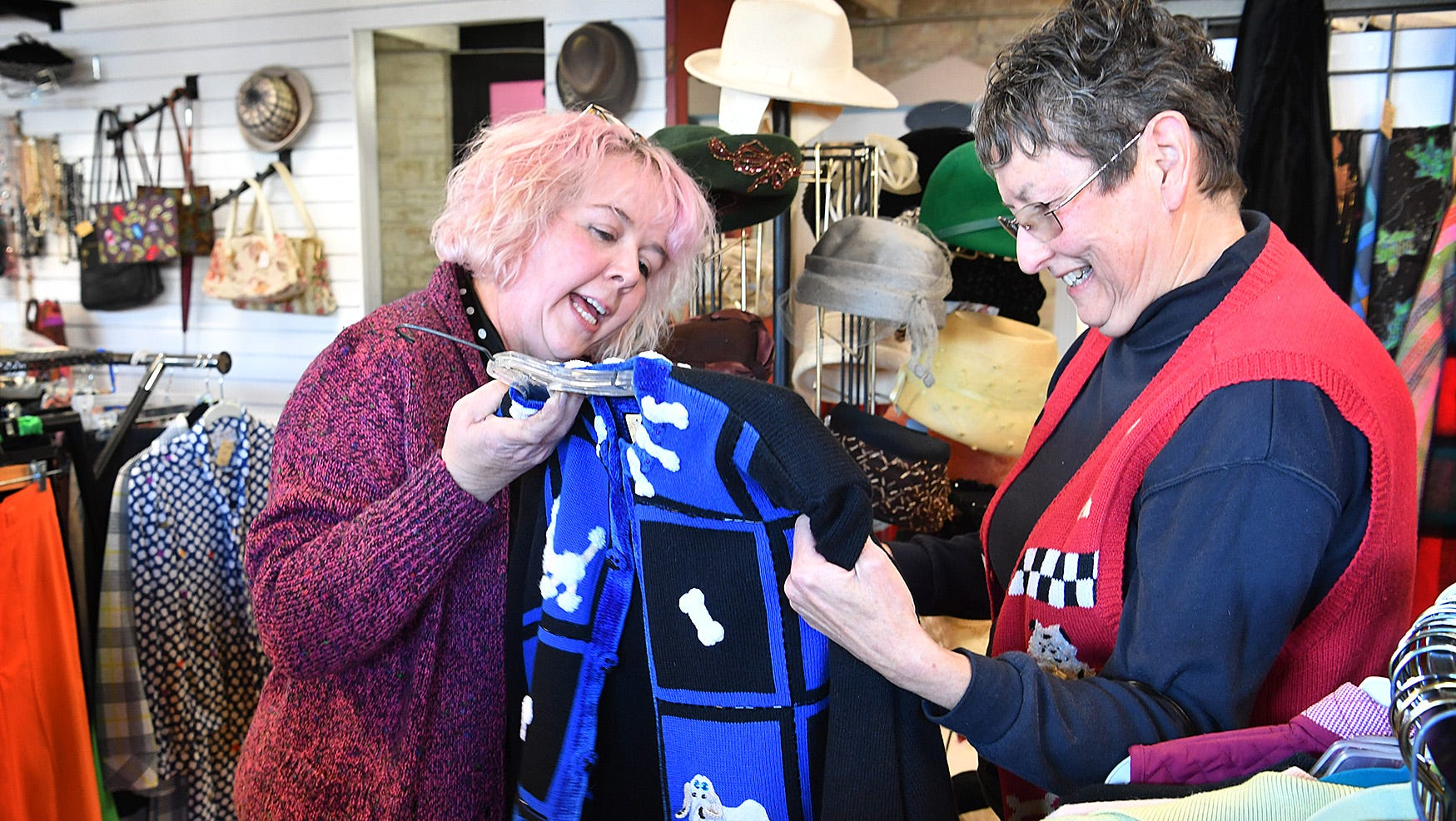 Janet Ehling, left, of Fashion Garage, works with customer Joann Spivey at the new vintage clothing boutique on Lamar.