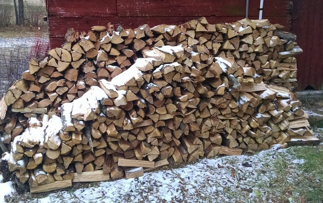 The woodpile, many times larger than the one pictured here, stood ready for the long, cold winter ahead.