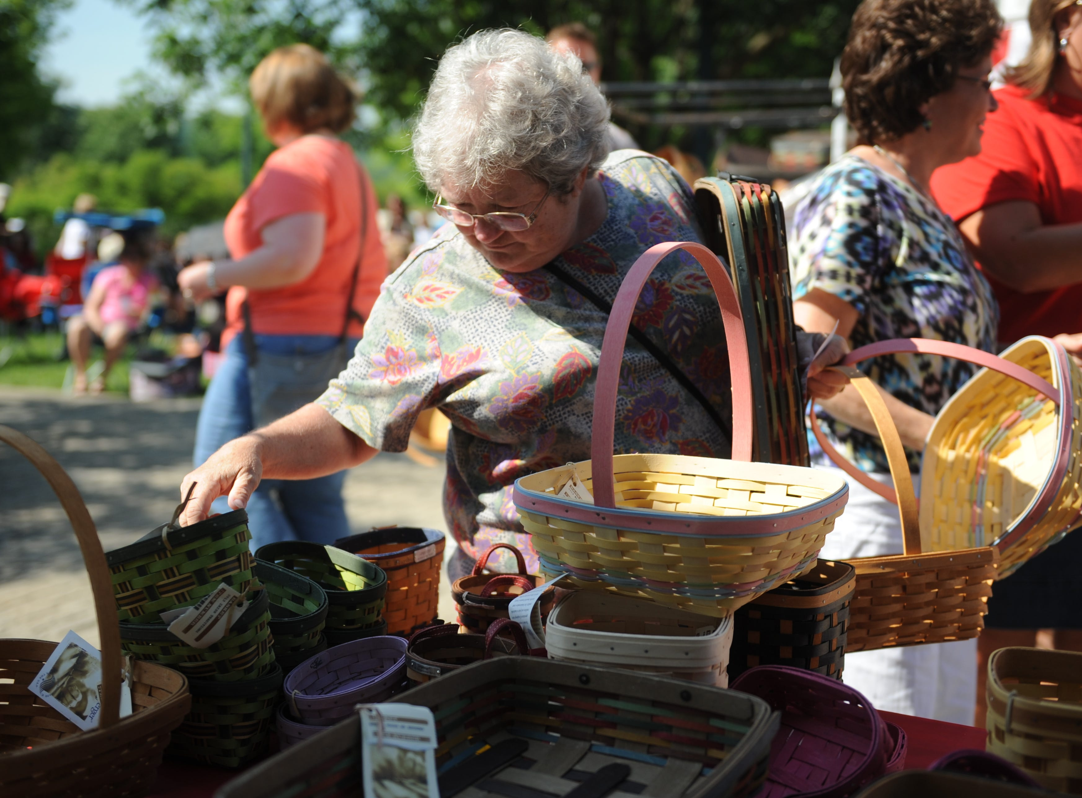 Diane Melvin of Flatwoods, W. Va. picks out baskets after winning at Basket INGO. Bingo numbers are called out and participants receive free Longaberger baskets. Longaberger's Great American Picnic Celebration continued on Saturday at Longaberger Homestead.