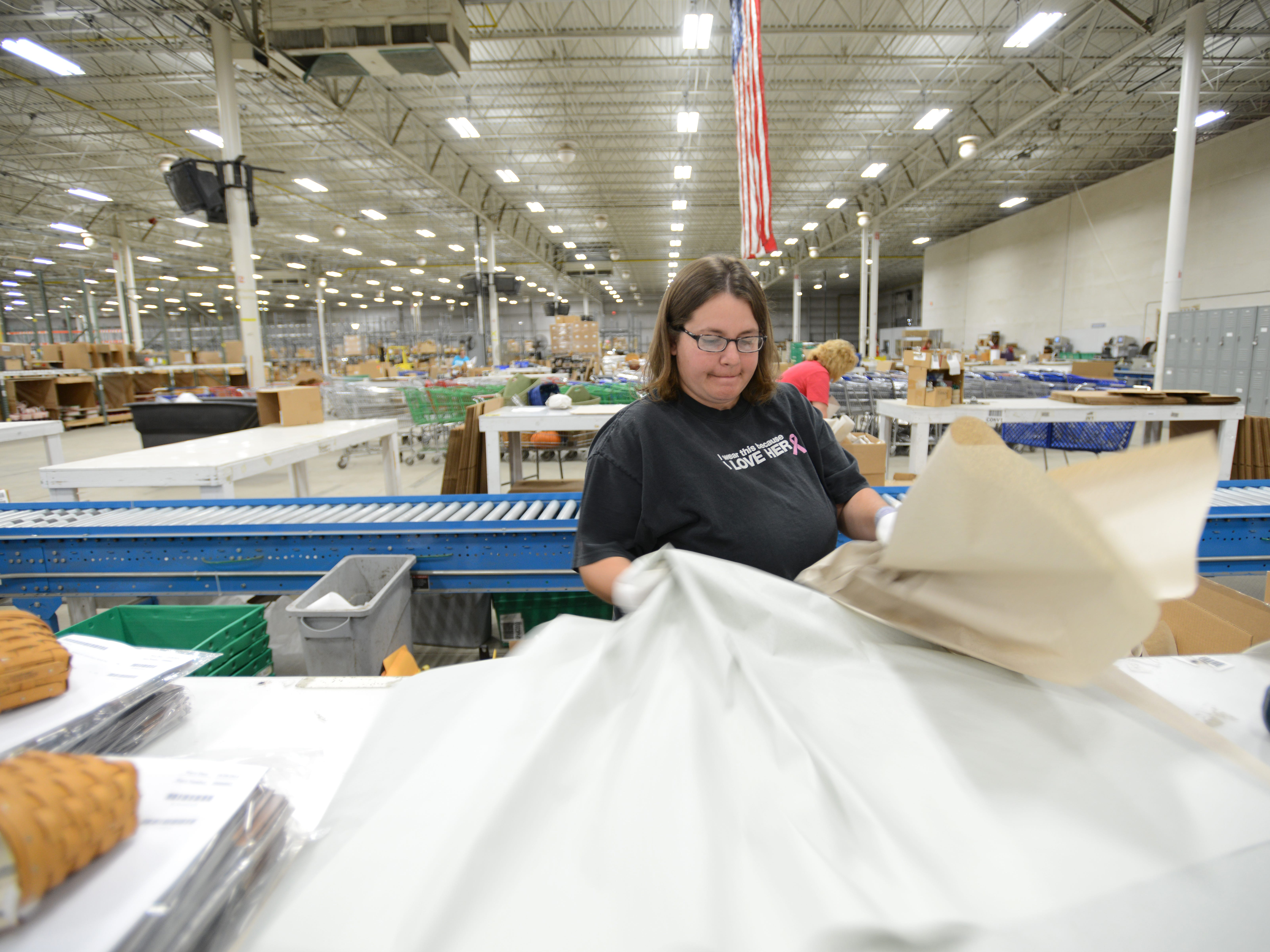 Jennifer Church packages baskets in Longaberger's shipping center on the company's Frazeysburg Campus.