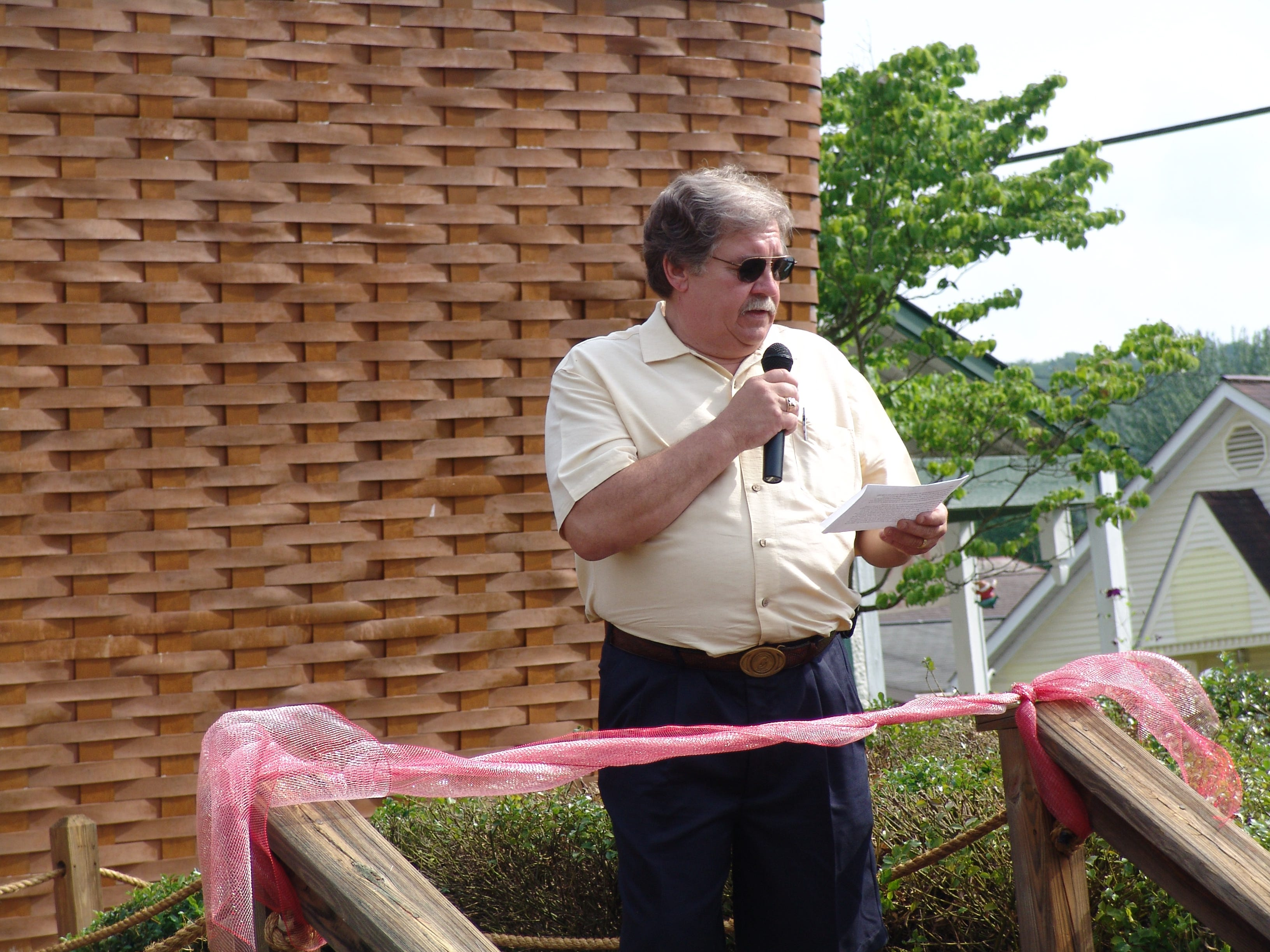 The Longaberger Company, Friends of the Dresden Parks, Inc, and the Village of Dresden held a rededication of the world's largest basket located on Main St. in Dresden on Sunday evening. The band Markham played following the ribbon cutting ceremony. The rededication followed restoration of the basket and coincides with the 40th anniversary of the Longaberger Company.
