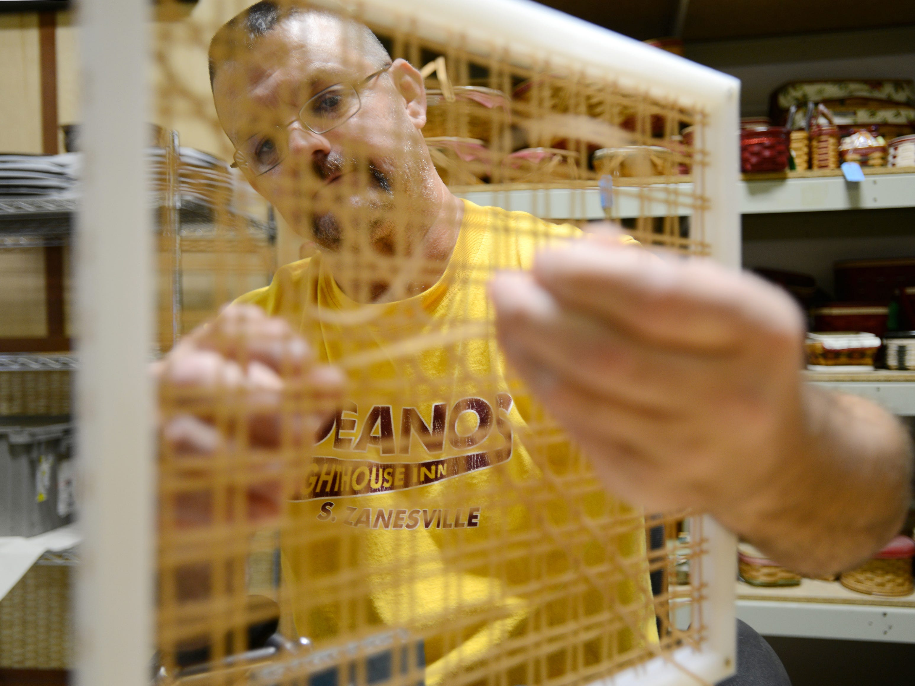 Mark Beach weaves a basket in Longaberger's Master's Studio line. The basket, called the Serenity, takes an entire shift to weave.