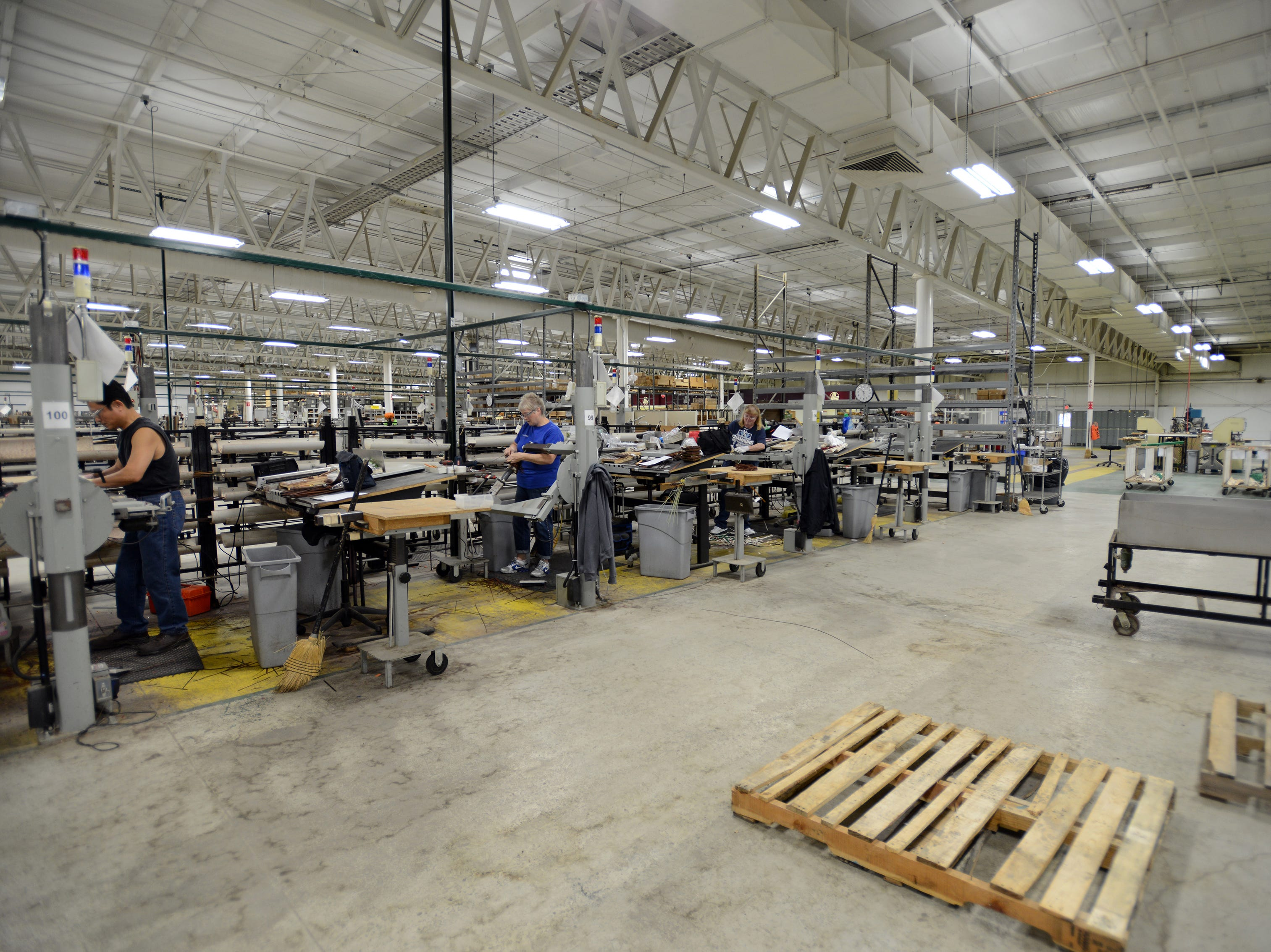 Workers assemble baskets at Longaberger's Frazeysburg manufacturing facility.