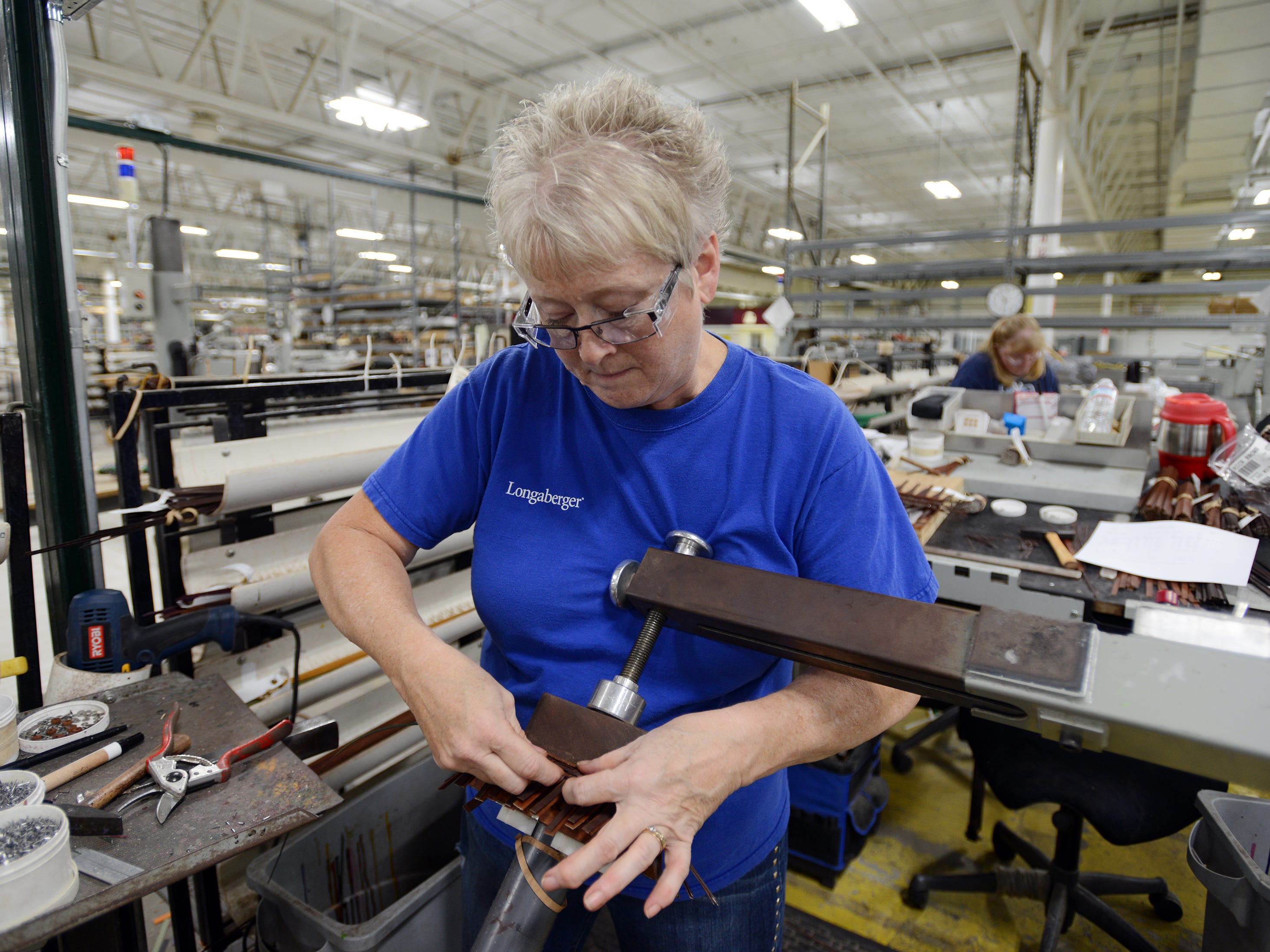 Pam Wheeler makes a small basket at Longaberger's factory in Frazeysburg.