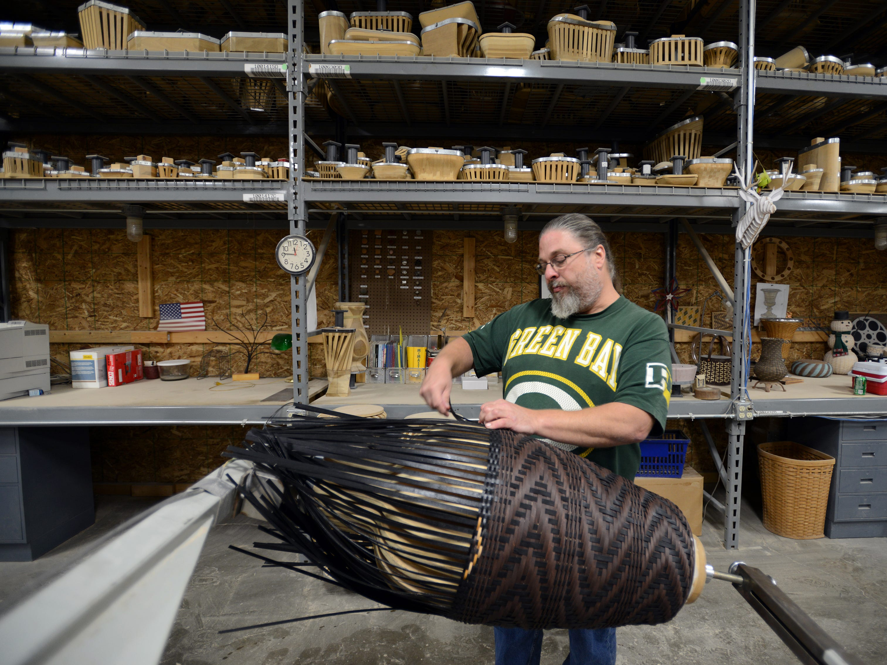 Brian Diltz, one of two Longaberger weavers who design the company's baskets, weaves a Santa Fe Urn in the company's Longaberger Couture line.