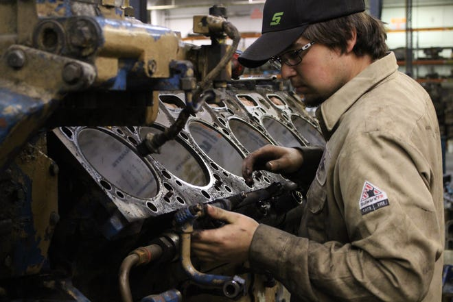 Mechanic J.R. Knipe at Producers Service Corporation repairs an engine. The local oil and gas pumping company,employs approximately 125 people, and expects to grow over the next decade.
