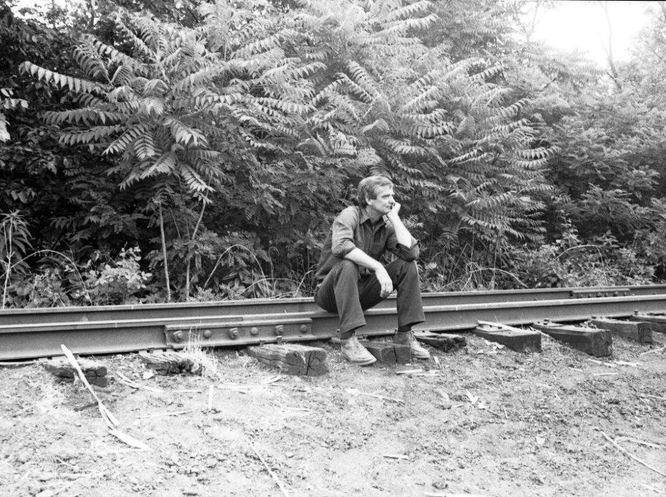 The photo that inspired the revamped Dave Longaberger memorial in downtown Dresden show Longaberger in his favorite thinking spot on the railroad tracks near early Longaberger facilities in Dresden.