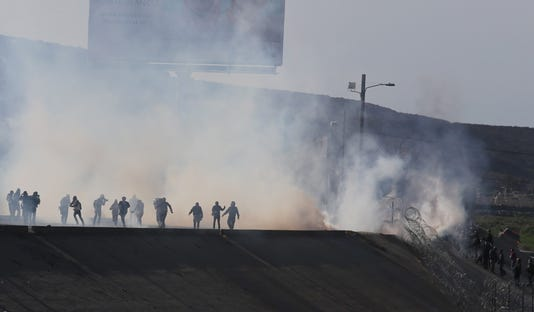 Migrants Try To Cross Wall With Usa And They Receive Tear Gas