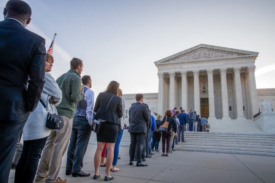 People line up at the Supreme Court on the first day of the new term, on Capitol Hill in Washington, Monday, Oct. 1, 2018.