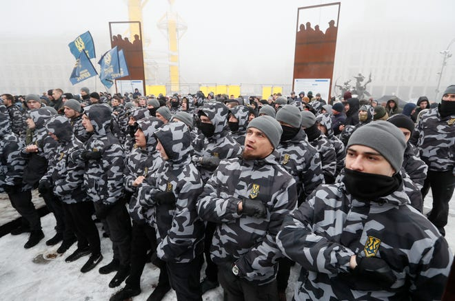 Ukrainian Nationalists attend a rally in front of the presidential office in Kiev on Nov. 26, 2018, as they demand to break diplomatic relations with Russia and nationalization of Russian property in Ukraine.