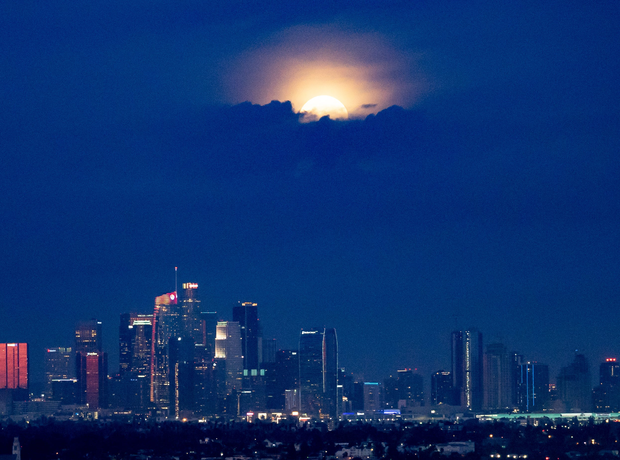 The Los Angeles downtown, with a full moon peeking through the clouds