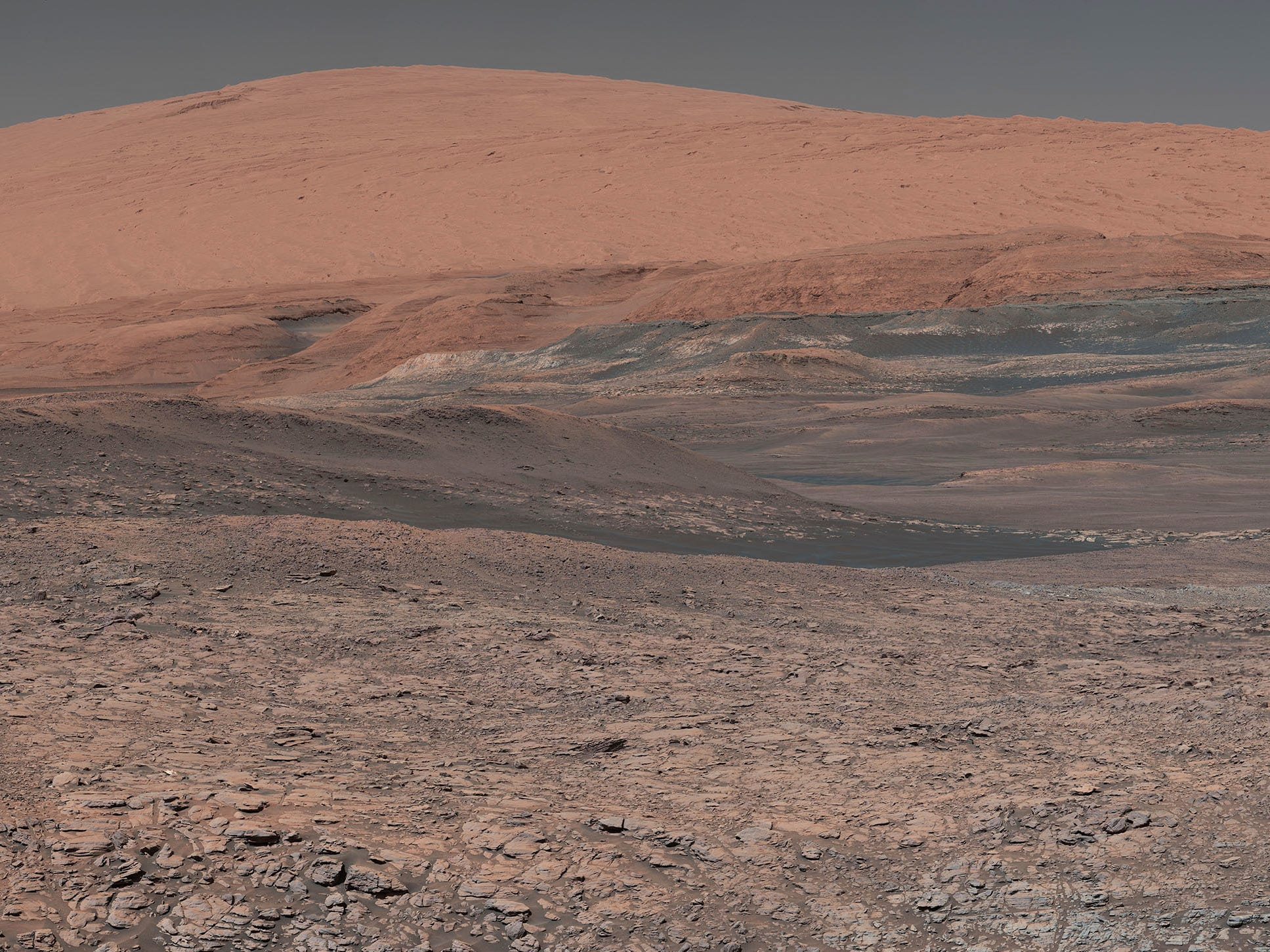 "This image provided by NASA, assembled from a series of January 2018 photos made by the Mars Curiosity rover, shows an uphill view of Mount Sharp, which Curiosity had been climbing. InSight is a Mars lander designed to study the ""inner space"" of Mars: its crust, mantle, and core."