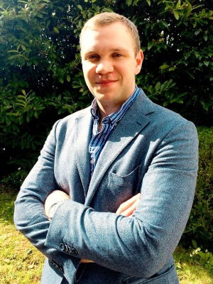 In this file photo taken on November 23, 2018 A handout picture taken in 2016 and released by the family of Matthew Hedges in London on November 23, 2018, shows British student Matthew Hedges posing at his home in Exeter, southwestern England.