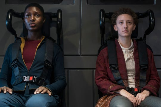 "Jodie Turner-Smith as Melantha, Maya Eshet as Lommie on ""Nightflyers."""
